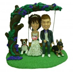 custom cake topper on a swing