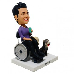 custom female bobble in a wheelchair with a pet