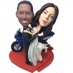 customised wedding bobblehead beside a motorbike