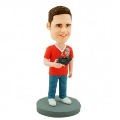 personalised gamer bobblehead carrying a gamepad