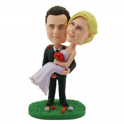 personalised wedding cake topper groom holding up bride