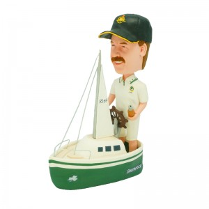 custom bobblehead sailing man holding a bottle of wine