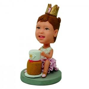 custom girl bobblehead with a cake