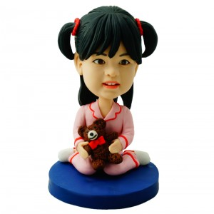 customised deary girl in pajamas carrying a bear doll